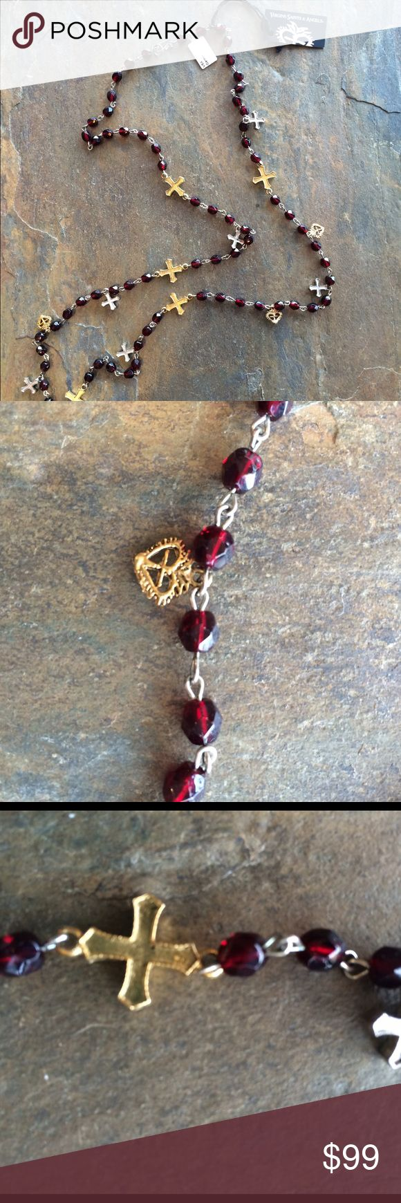 VSA long garnet necklace Virgin, Saints & Angels beautiful garnet necklace with silver & gold crosses.  New with tags.  Would look great alone or layered with other necklaces. Virgin Saints & Angels Jewelry Necklaces