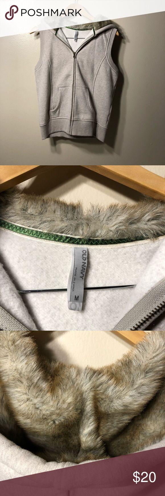 "Old Navy  Fleece Vest with Fur Lined Hood Old Navy Fleece Vest with Fur Lined Hood Size Medium. Length 20.5"" armpit to armpit 20"" light gray Old Navy Jackets & Coats Vests"