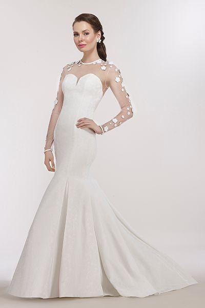 Wedding gown by Steven Birnbaum Bridal.