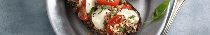 If you like Caprese salad, you'll love this variation on the theme! In just 25 minutes, you'll have a dish that combines the fresh flavors of a salad with the tanginess of balsamic vinegar and the heartier qualities of eggplant, organic quinoa, and brown rice.