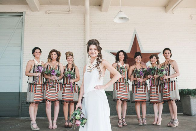 Love the striped bridesmaids' dresses with pom pom fringe!