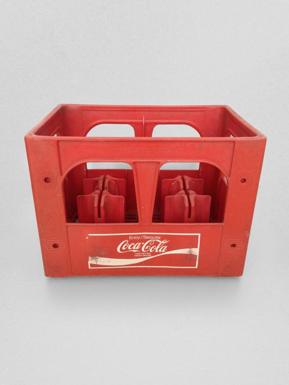 "This large commercial plastic Coca Cola crate was salvaged from an old out of commission convenience store. Never available to the public, this crate is emblazoned with ""Property of Coca-Cola Ltd"" and features an old school Coke logo. There are four protruding dividers that make us think it was created for storing and transporting 1L glass bottles, but we cannot confirm this."