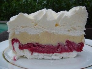 Vacherin glacé - French dessert with a layer of meringue, vanilla ice cream, raspberry sorbet, and a top layer of meringue; all layered in a springform pan. With whipped cream as a frosting on the outside once it's been unmolded and its ready to be served.