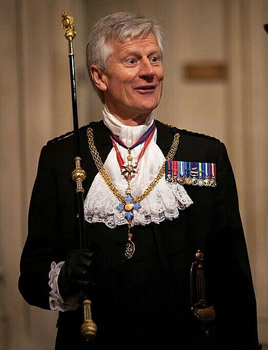 Gentleman Usher of the Black Rod, Lieutenant-General David Leakey, prepares to escort members of parliament into the Chamber of the House of Lords to listen to the Queen's Speech delivered by Britain's Queen Elizabeth II for the State Opening of Parliament