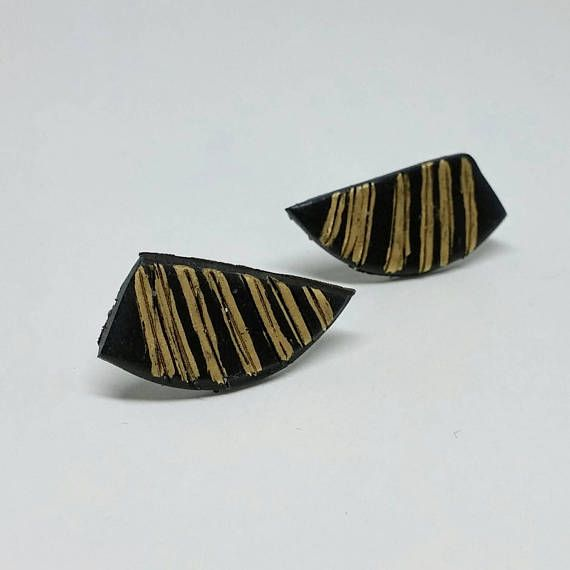 Check out this item in my Etsy shop https://www.etsy.com/ca/listing/509811016/black-and-gold-striped-wing-studs