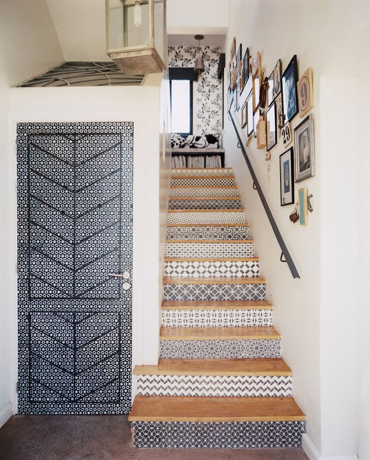 Stenciled stair risers and a gallery wall at Peacock Pavilions guesthouse, Marrakech.