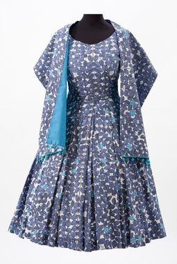 """Leaf print dress and shawl, made by Alice Israel-Svensson of fabric """"Romans"""" designed by Viola Gråsten, ca. 1950s."""