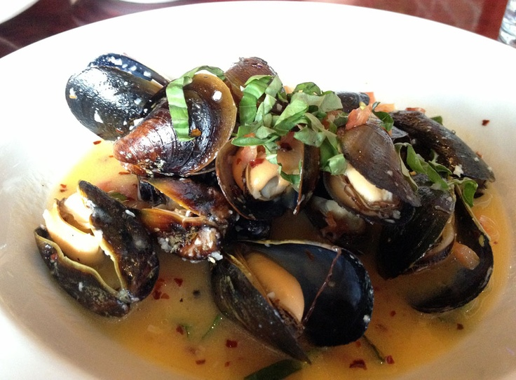 fresh steamed mussels in a spicy white wine butter sauce with tomato ...