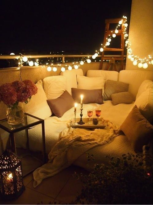 Go all out with cushions, pillows and string lighting.