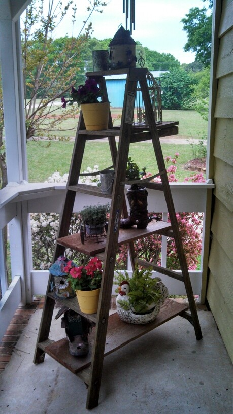 Old wooden ladder used on porch cute wood ladder decor for Old wooden ladder projects