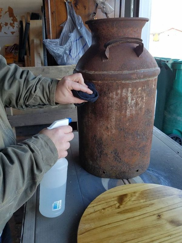 Step 1: Prep your milk can for paint. Spray the milk can with a vinegar/water 50/50 mix solution and wipe away any loose rust, dirt, and grime. Let dry.