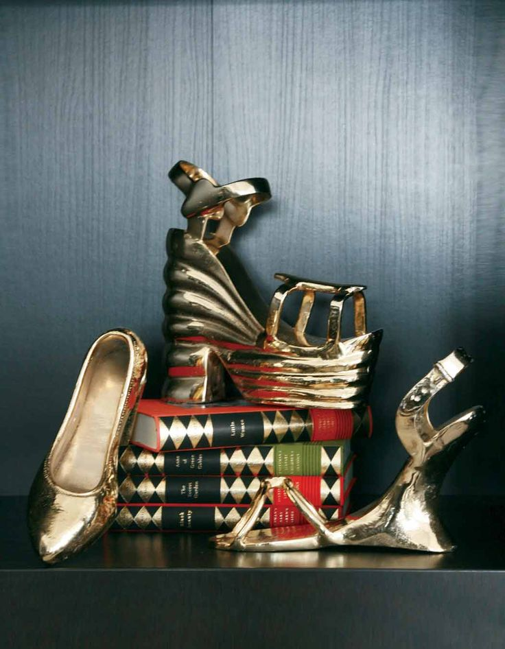 You can never have enough Gold Shoe Bookends by Nima Oberoi Lunares.