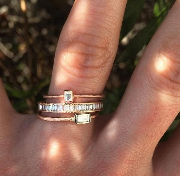 This 10K rose gold ring from Rebecca Lankford Designs features a bezel set baby baguette diamond. Stack this rose gold ring for a playful, trendy look.