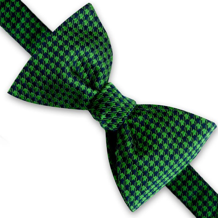 The Clarence self-tie Bow Tie, made from 100% silk, featuring a houndstooth design that adds a fun touch to a classic outfit. #BowTie #Silk #Green #Navy