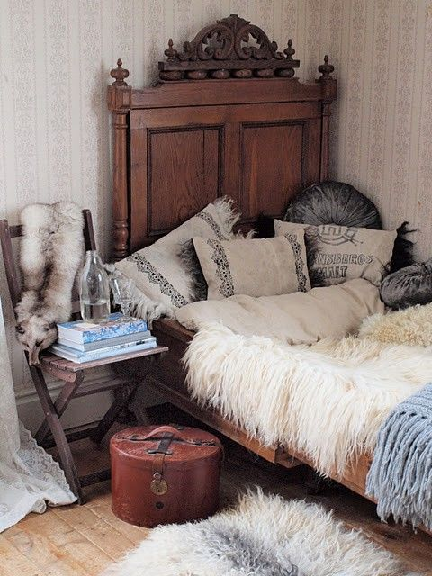 Vintage Bedroom: Ornate and elegant vintage headboard piled high eclectic pillows and throws. Bohemian style at it's best.