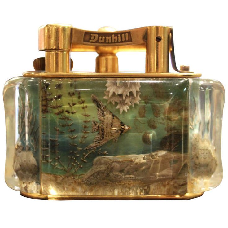 Dunhill Reversed Carved and Painted Aquarium Lighter, 1950 | From a unique collection of antique and modern decorative objects at http://www.1stdibs.com/furniture/more-furniture-collectibles/decorative-objects/
