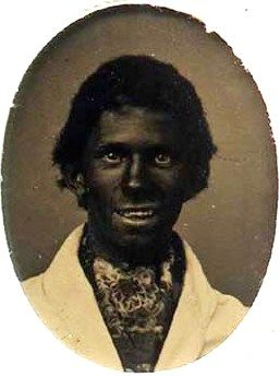 An actual pre-Civil War photograph of a white actor decked out in 'black face' makeup during the early days of the popular racist Minstrel Shows of the 19th and early 20th centuries.