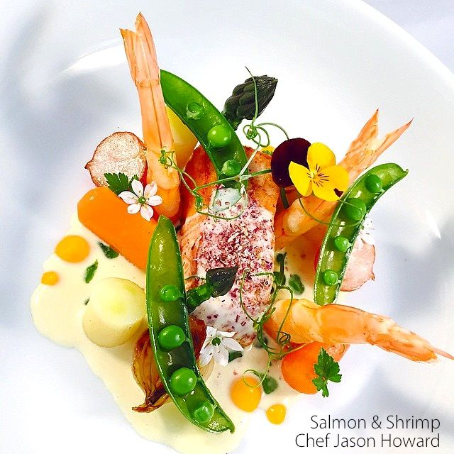 Salmon and Shrimp by Chef Jason Howard. Salmon and shrimp, scotch veg served together with fresh peas, pea sprouts, squash & ginger purée finished with a white wine shellfish sauce. #fish #shellfish #salmon #shrimp #pescatarian