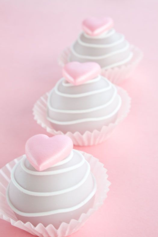 cake balls for the baby shower. Like the idea of displaying them in cupcake liners. The hearts are cute too.