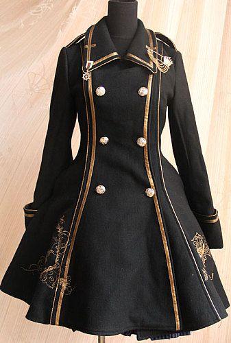 黒と金のスマートな服は見栄えが良い