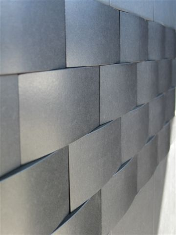 The tiled was installed in waved way. It makes the wall looks more interesting.