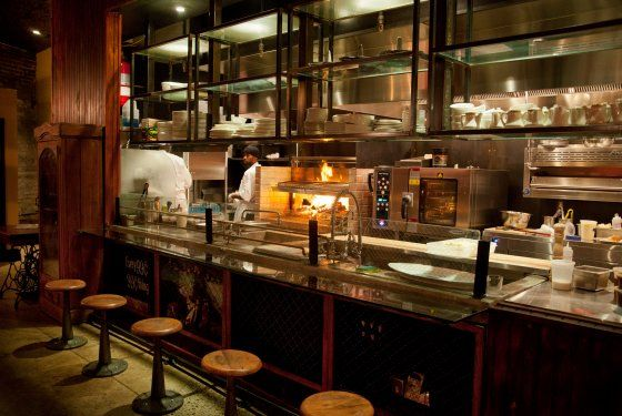There is no signage outside this neo-speakeasy steakhouse, although once you navigate your way inside the warm room you'll find many satisfying totems of the chophouse experience. The menu is a large, somewhat imposing document, stocked with all sorts of nose-to-tail specialties like housemade blood sausage, sweetbreads, and lavish cuts of meat (Châteaubriand for two, côte du boeuf), which Hugue Dufour and his cooks sizzle over crackling logs on an open grill.