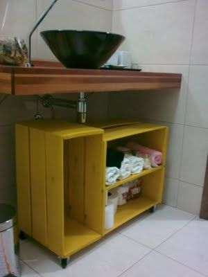 painted crates with added wheels for storage under my sewing table for additional sewing machine ('s) Lol :-)
