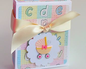 Very cute gift boxes for new moms and their baby girls - contains two standard bibs.  Perfect for baby showers, or baby's first birthday.  The little pram embellishment can be changed for a boy! Click through to my shop. #babygirl #babybibs #giftideas #eastergift #firstbirthday