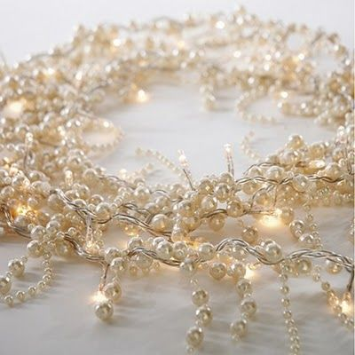 Pearl lights would be stunning wrapped into a centerpiece or up the sides of an arch at the ceremony