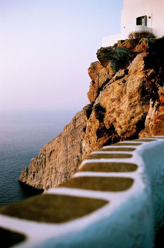 This is my Greece   The harsh cliffs to the sea dressed in a golden sunsetting light in Folegandros island in souther Aegean