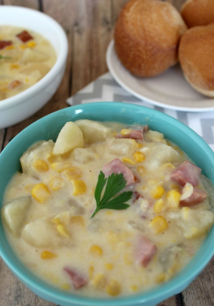A Sweet and Creamy Crockpot Corn Chowder that is hearty, filling, and delicious.  Enjoy the tastes of the season with this simple and easy meal made in a slow cooker!