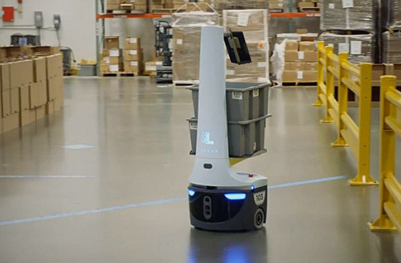 Locus robot traveling a Quiet Logistics fulfillment center