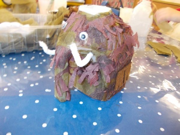 Stone Age art idea - woolly mammoth simply made from plastic milk carton, paper and white pipe cleaners! From https://blogs.glowscotland.org.uk/cl/ClackmannanNursery/2013/03/08/dinosaur-fun/