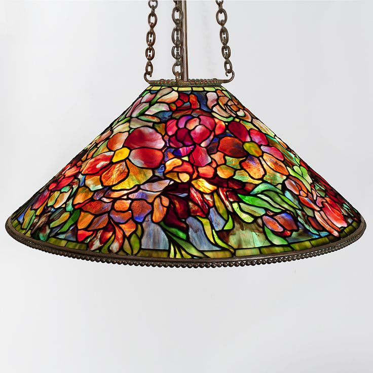 "Tiffany Studios New York ""Bouquet"" Leaded Chandelier  A Tiffany Studios New York ""Bouquet"" leaded glass and patinated bronze chandelier. Circa 1900. A similar shade is pictured in: Tiffany Lamps and Metalware: An illustrated reference to over 2000 models, by Alastair Duncan, Woodbridge: Suffolk: Antique Collectors' Club, 1988, p. 216, plate 851. Shade signed: ''Tiffany Studios New York''."