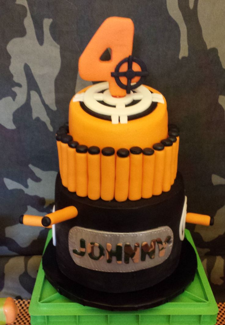 Nerf gun birthday cake!!! Camouflage, Nerf darts, targets! Perfect for a 4 year old boys birthday party or any age!!! Made by https://www.facebook.com/SweetthingsCupcakery