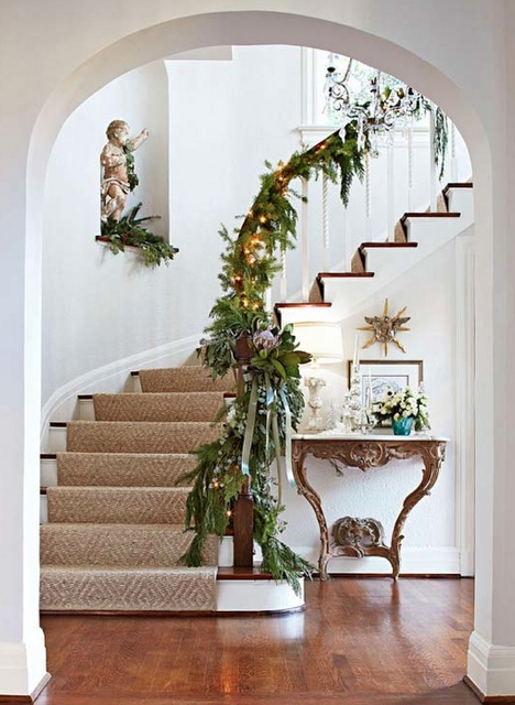 I want a staircase like this so I can add fresh greens!  Love the cherub tucked in the nook!