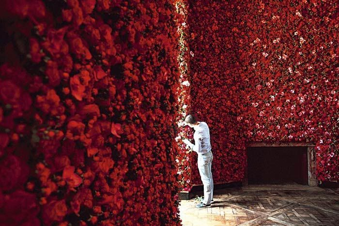 One million flowers blanketed the walls of Christian Dior's July show during Paris Fashion Week. The Bureau Betak-event included a room covered with red roses.