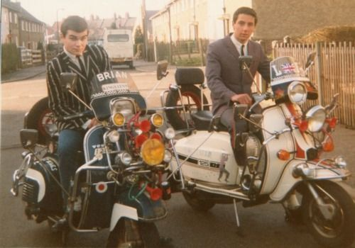 Mod revival, white socks, skinny tie and boating blazer ! any idea where or whom? Brian?