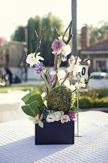 purple and green modern branch centerpieces
