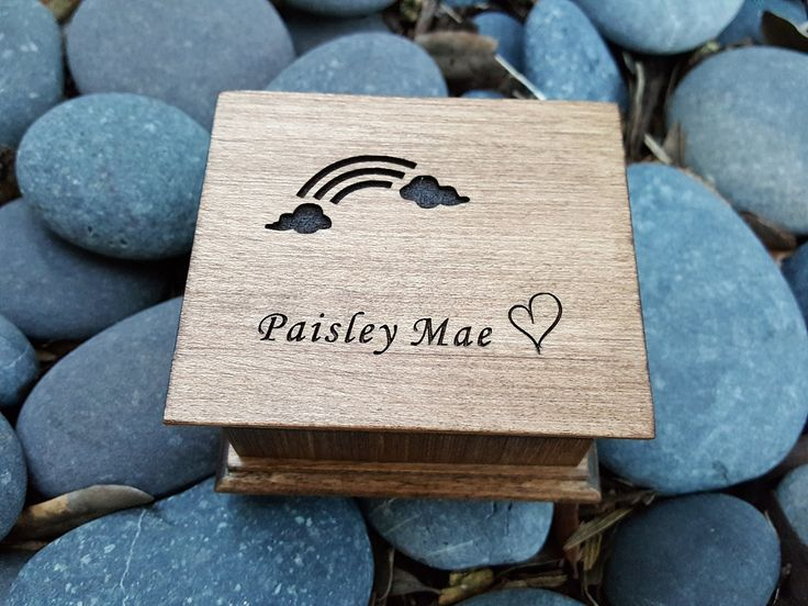 Custom engraved wooden music box with a rainbow, a heart and your choice of name engraved on the top with your choice of color and song