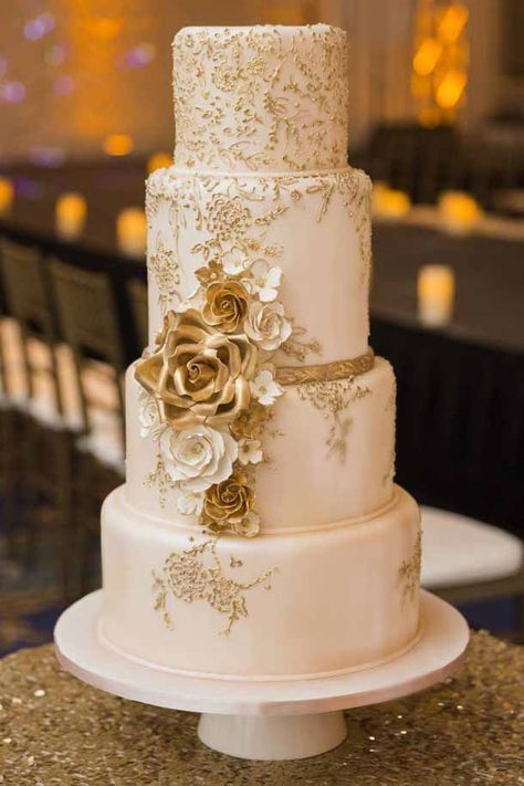 Vintage luxury gold wedding cake with gold flowers