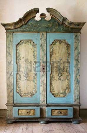 antique painted cupboard old hand made furniture in wood with drawers and doors Stock Photo