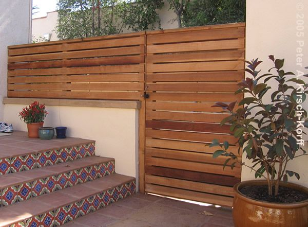 interesting idea for horizontal fencing to cross from garden into back wall.