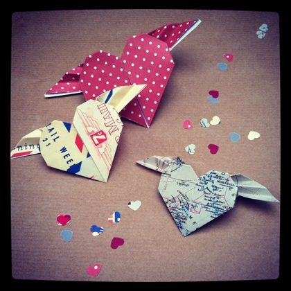 How to make origami flying hearts; put vellum envelope on front of card with some of these inside