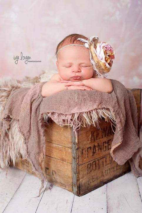 our best selling headband in one of our simplest designs  this design features a single stacked rose in rose pink,gold, cream adorned with lace,burlap,pearls and an ostrich feather.  this headband is perfect for shabby chic,vintage, country, or rustic themed photo shoots.