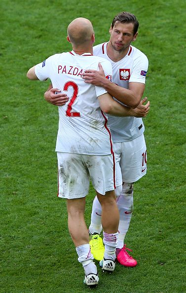 #EURO2016 Grzegorz Krychowiak and Michal Pazdan of Poland celebrate victory after the UEFA EURO 2016 round of 16 match between Switzerland and Poland at Stade...