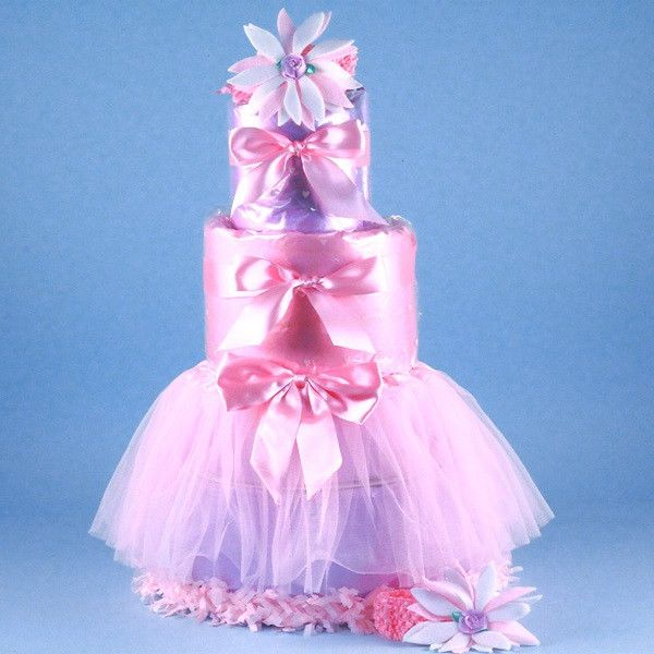 """Diaper Cake Description This gift has fabulous looks, impressive size (24"""" tall), and it includes adorable items that will have a baby girl looking the part of a prima ballerina in no time. The Tutu T"""
