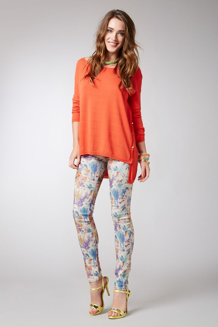 Boat neck sweater..............  Floral print trousers