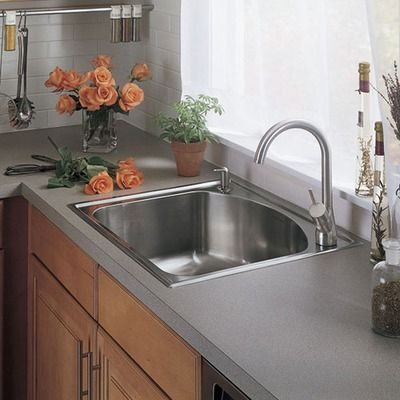 mount kitchen sink with vase of rose flowers httplanewstalkcom - American Kitchen Sink