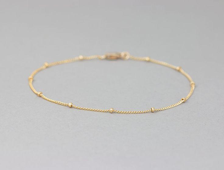 Delicate Gold Bracelet / Dainty Chain Bracelet / Thin Gold Chain / Layering Bracelet / DEW DROPS Bracelet by Layered and Long LB801 by LayeredAndLong on Etsy https://www.etsy.com/listing/195217981/delicate-gold-bracelet-dainty-chain